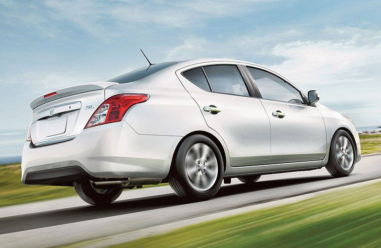 silver 2017 Nissan Versa exterior rear side view