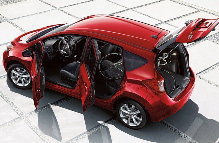 red 2017 Nissan Versa Note with all doors open seen from the top