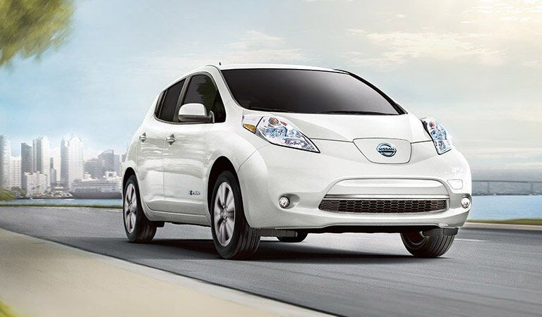 white 2017 Nissan Leaf driving down street