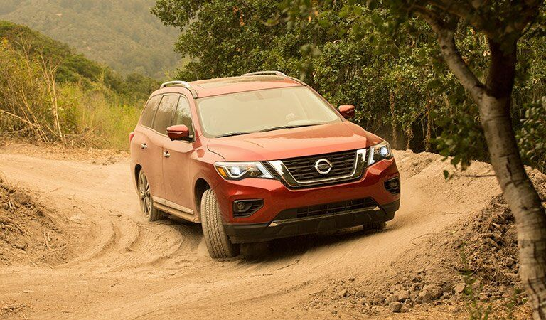 red 2017 Nissan Pathfinder covered in dirt