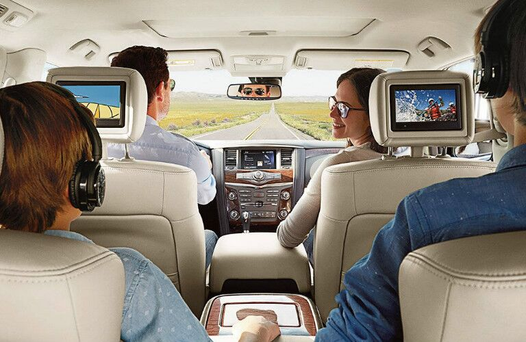 family sitting inside 2017 Nissan Armada
