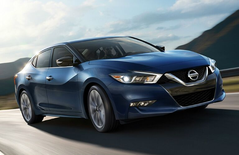 blue 2017 Nissan Maxima driving on highway