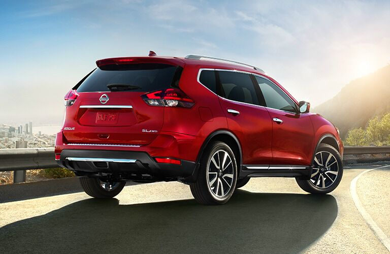 red 2017 Nissan Rogue seen from rear overlooking city