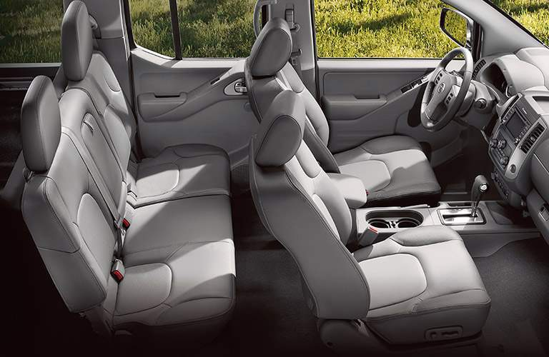 View of 2018 Nissan Frontier gray interior showing two rows of seating