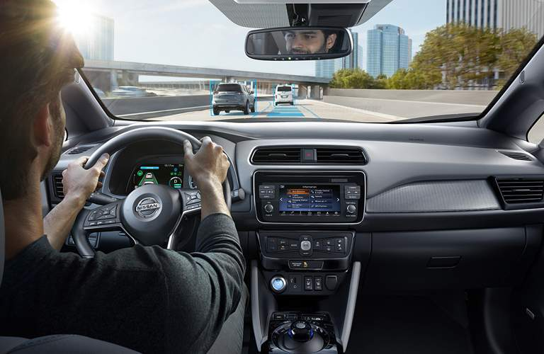 Interior view of a 2018 Nissan LEAF highlighting Driver Assistance features