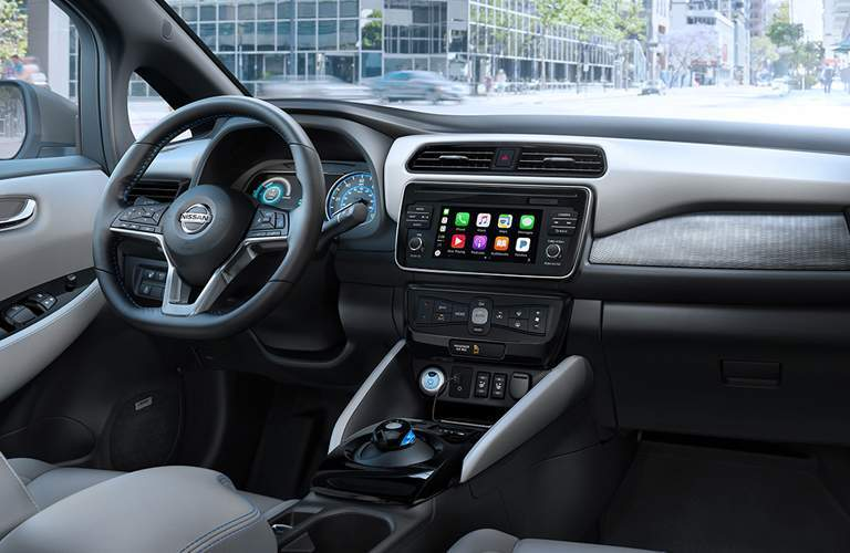 Interior view of the steering wheel and touchscreen of a 2018 Nissan LEAF