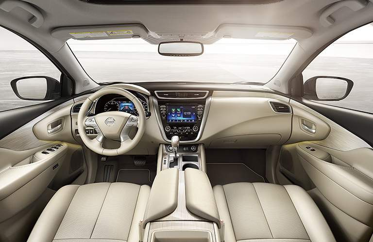 Interior view of the tan seating and steering wheel of a 2018 Nissan Murano