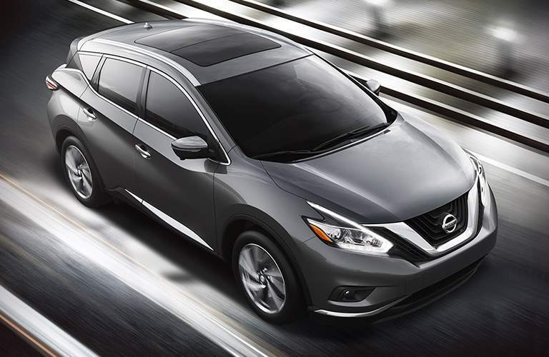 Exterior view of the front of a gray 2018 Nissan Murano driving down the highway