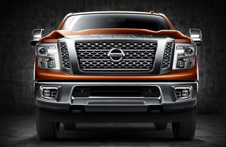 orange 2018 Nissan Titan XD front side view