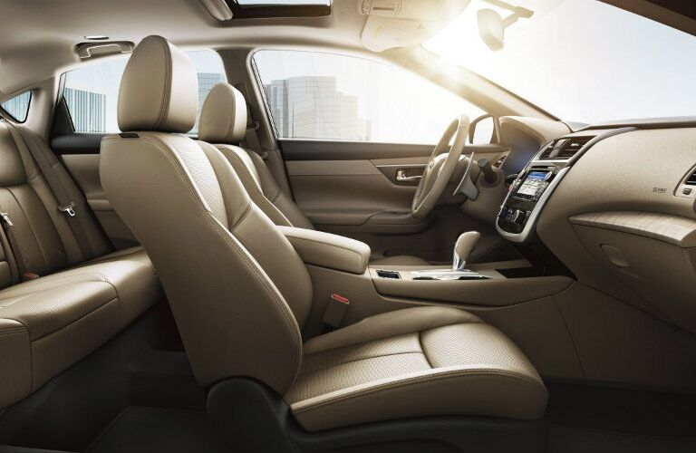 Interior view of the tan seating of a 2018 Nissan Altima