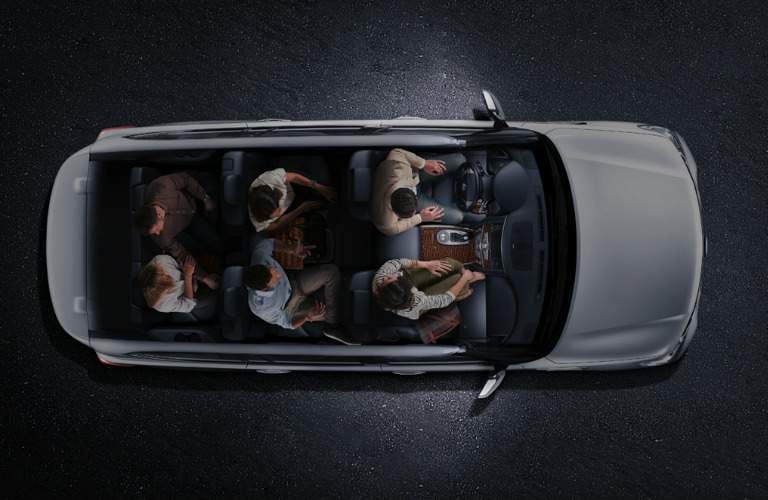 2018 Nissan Armada with see-through top showing people sitting inside