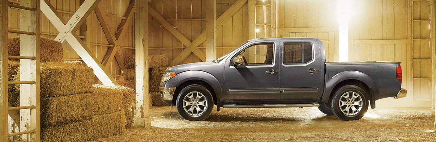 2018 Nissan Frontier parked in barn near hay