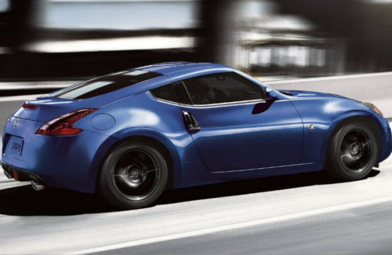 Exterior view of a blue 2019 Nissan 370Z driving down the highway
