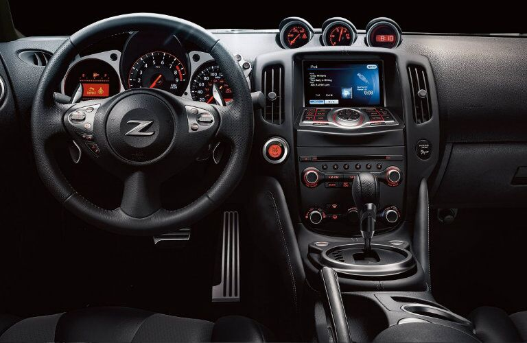 Interior view of the steering wheel and touchscreen infotainment system of a 2019 Nissan 370Z