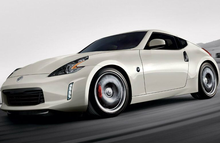 Exterior view of a white 2019 Nissan 370Z driving down the highway