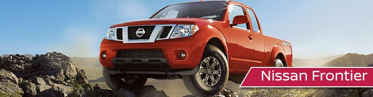 red Nissan Frontier front side view