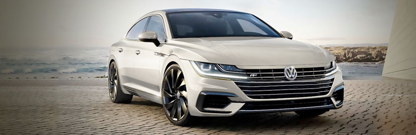 White 2019 Volkswagen Arteon parked in front of shore