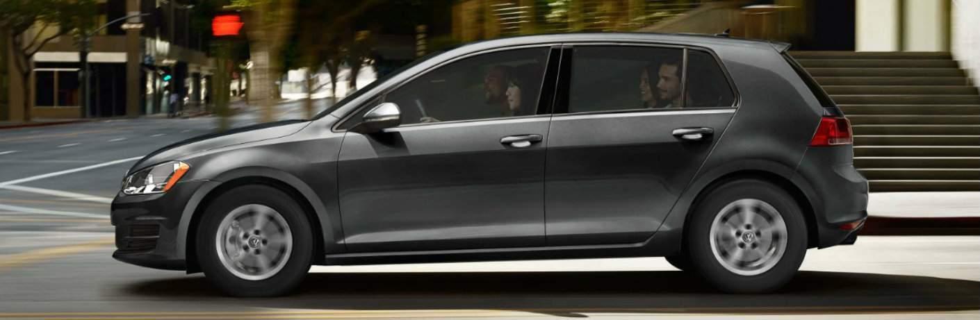 side profile of gray 2018 Volkswagen Golf full of passengers