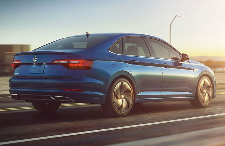 Rear passenger side exterior view of a blue 2019 VW Jetta