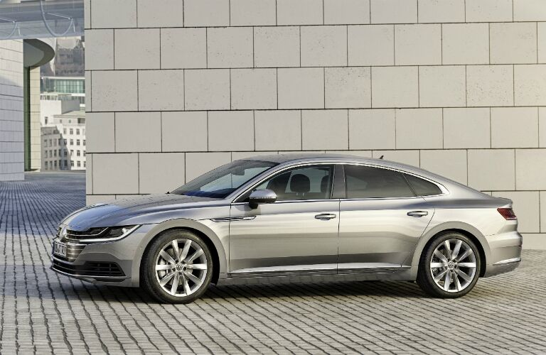 silver Volkswagen Arteon on bricked road