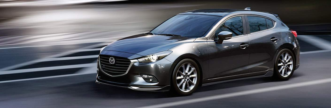 2018 Mazda3 hatchback exterior grey side on road