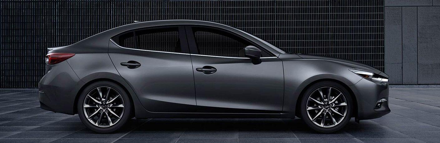 A right profile photo of the 2018 Mazda3 sedan.
