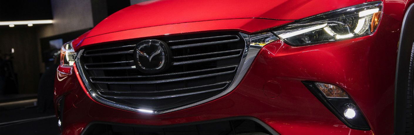 A close up photo of the new grille and LED headlights available on the 2019 Mazda CX-3.