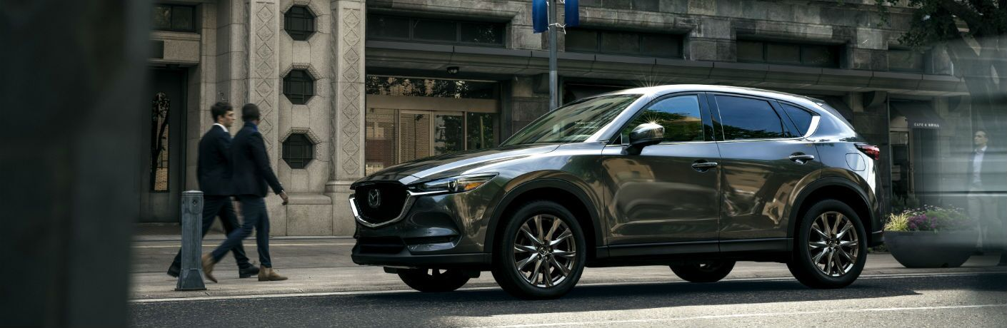 A left profile photo of the 2019 Mazda CX-5 parked on the street.