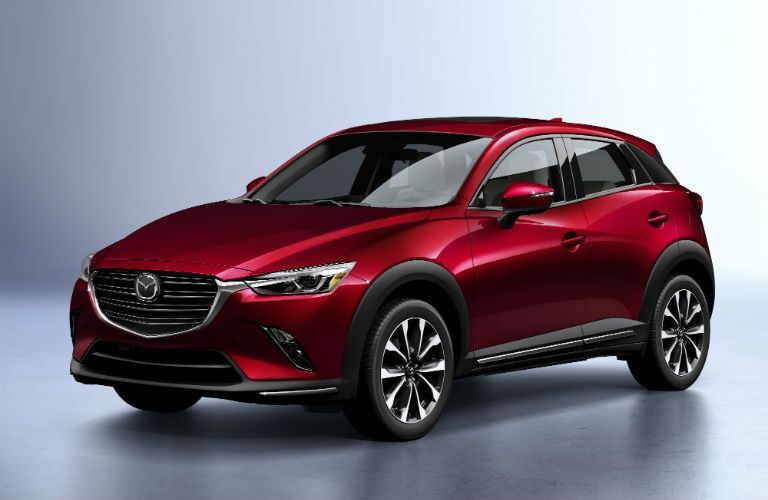 A front left quarter photo of the 2019 Mazda CX-3 in a photo studio.