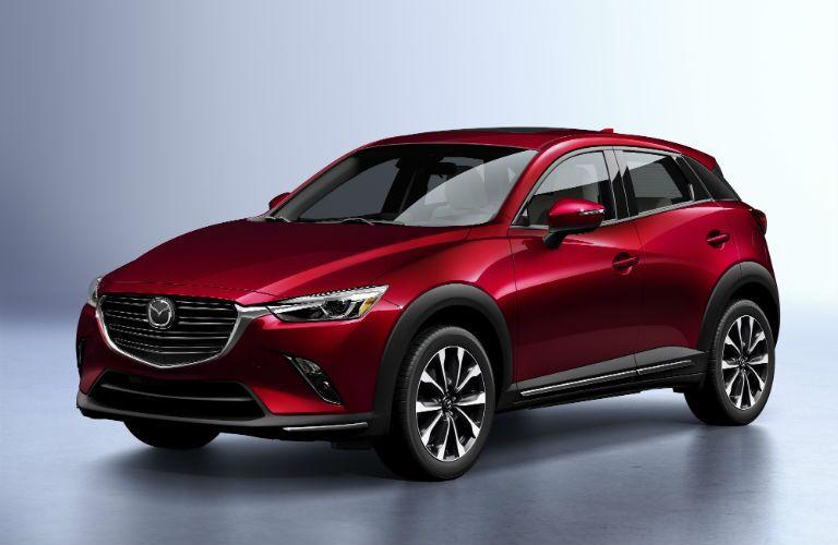 A front left quarter photo of the 2019 Mazda CX-3 in a photo studio.