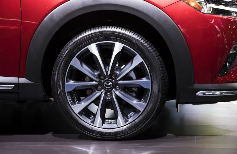A close up photo of one of the wheel designs available with the 2019 Mazda CX-3.