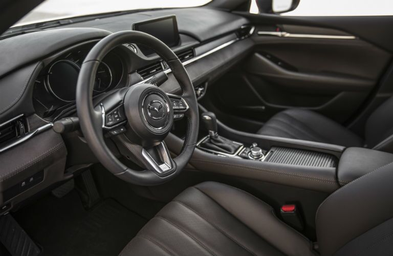 A photo of the driver's cockpit in the 2018 Mazda6.