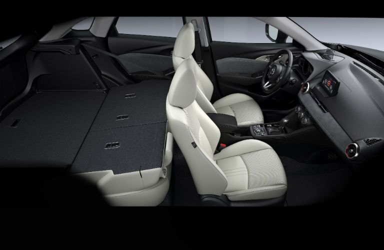 An interior photo of the rear seats folded down for max cargo capacity in the 2019 CX-3.