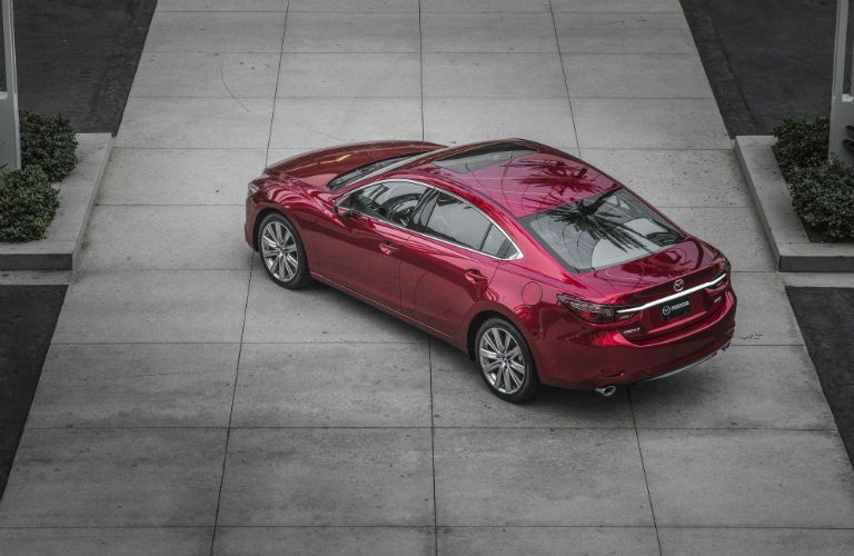 An overhead photo of the 2018 Mazda6 parked in front of a building.