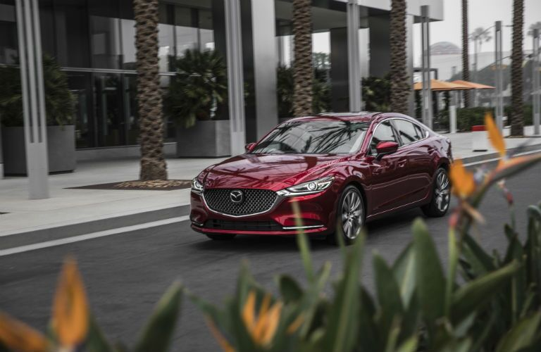 A front right quarter photo of the 2018 Mazda6 parked in front of a building