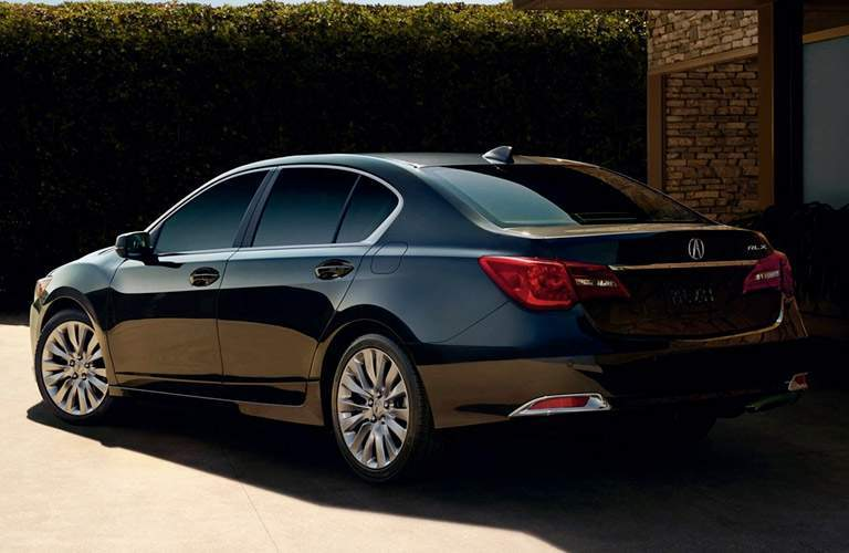 Rear shot of 2017 Acura RLX parked in front of hedge