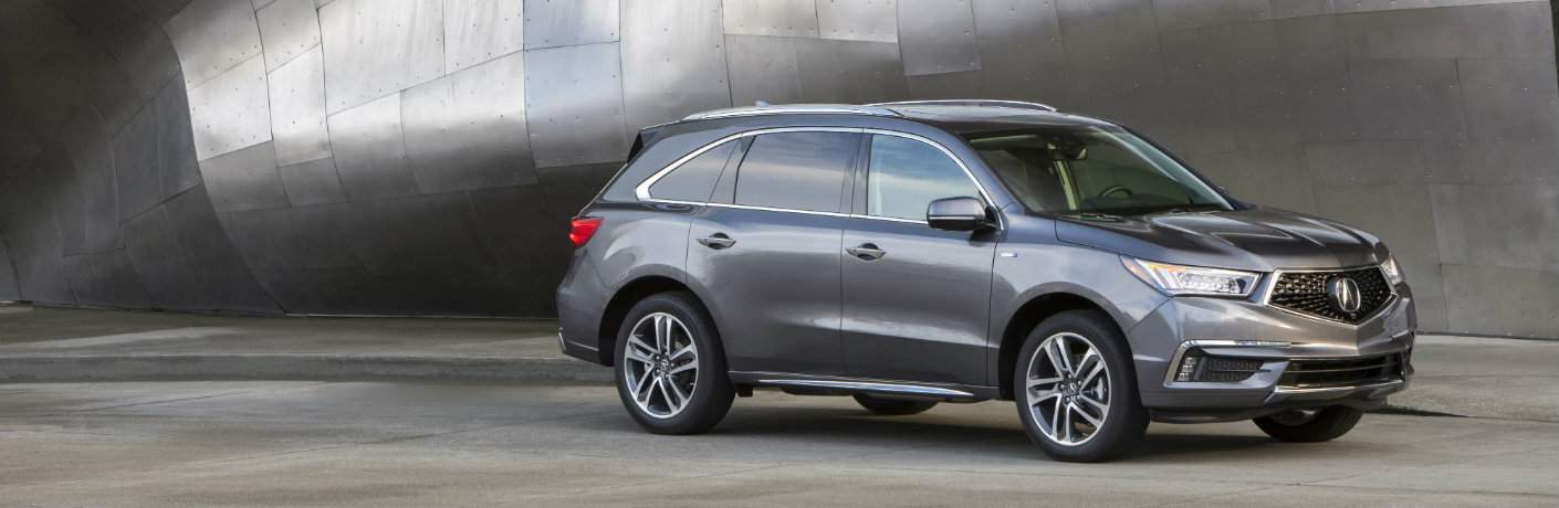 gray 2018 Acura MDX Sport Hybrid parked in front of metal structure