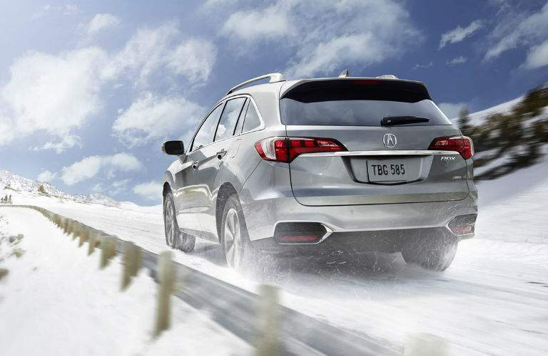 2018 acura rdx rear view driving in snow