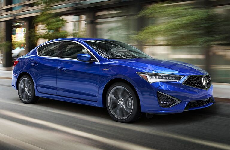 Blue 2019 Acura ILX driving on city road