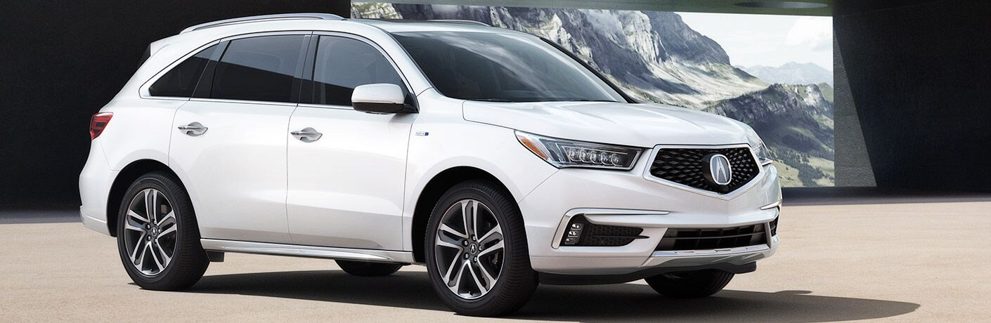 front-side view of white 2019 Acura MDX