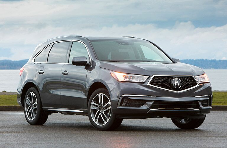 front view of gray 2019 Acura MDX parked by lake
