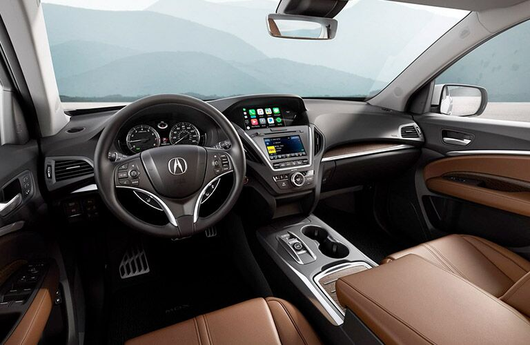 steering wheel, dashboard, and light brown seating in 2019 Acura MDX