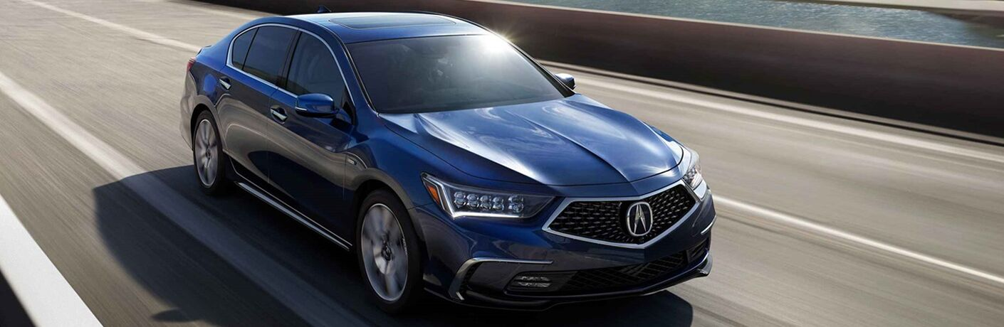 Blue 2019 Acura RLX driving on highway bridge
