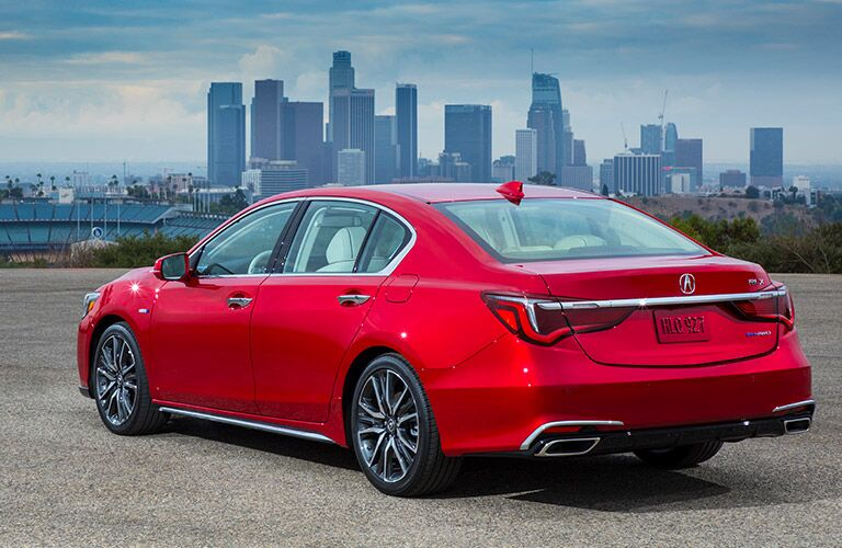 Rear shot of red 2019 Acura RLX parked in front of city skyline