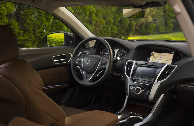 Steering wheel and touch screen inside the 2019 Acura TLX
