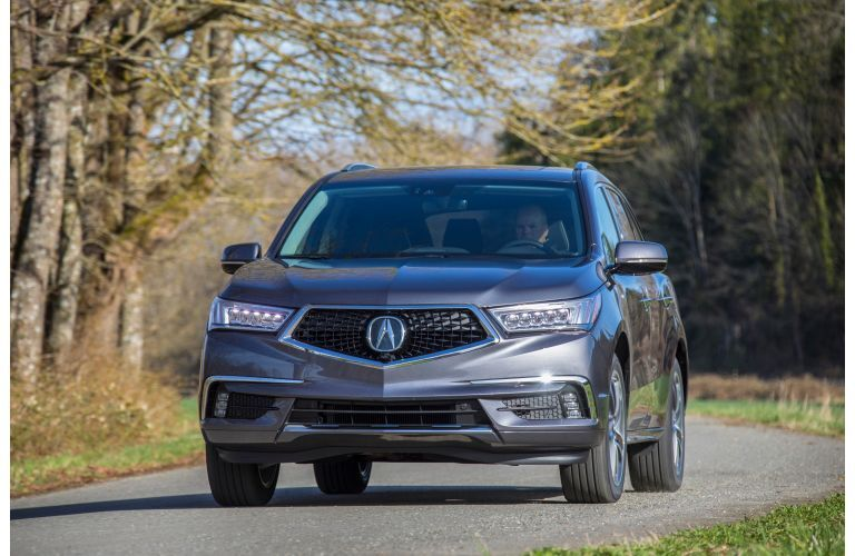2020 Acura MDX on a wooded road