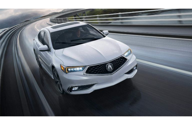 2020 Acura TLX on a rainy highway