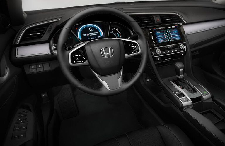 Interior view of a 2018 Honda Civic closeup of steering wheel and infotainment touchscreen