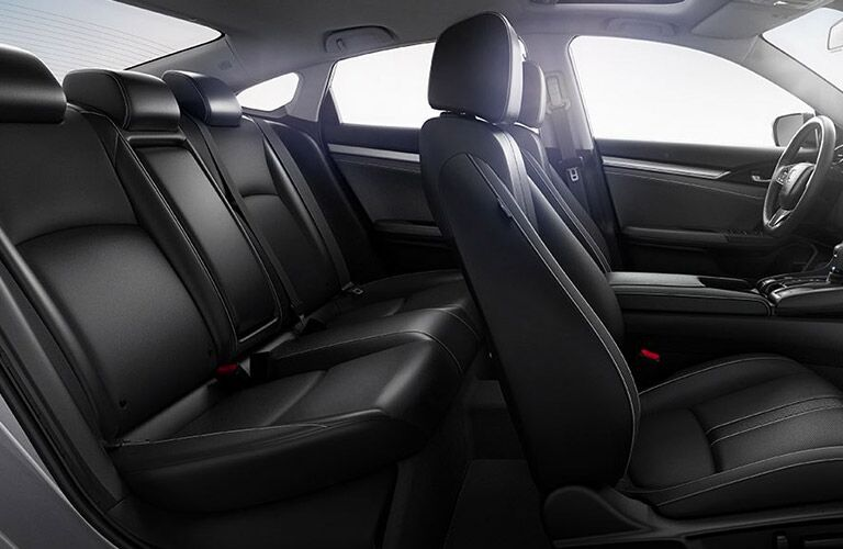 Interior view of a 2018 Honda Civic showing full interior and black seating