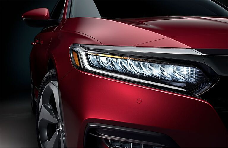 Exterior view of red 2018 Honda Accord closeup on passenger-side headlight